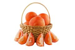 Tomatoes in a basket on white isolated background Stock Photos