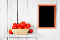 Tomatoes in a basket. Royalty Free Stock Photos