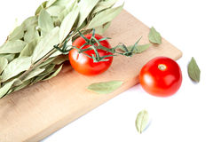 Tomatoes and bay leaf Royalty Free Stock Image