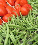 Tomatoes and beans at farmers' market Stock Image