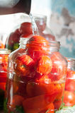 Tomatoes being swamped boiled water in process of Royalty Free Stock Photo