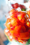 Tomatoes being swamped boiled water in process of Royalty Free Stock Images