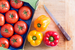 Tomatoes and Bell Peppers on Top of Chopping Board Stock Photo