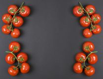 Tomatoes on a black background. Dietary food. Vegetables on a black background.  Tomatoes on the table. Tomatoes on a black background. Dietary food. Vegetables Stock Images