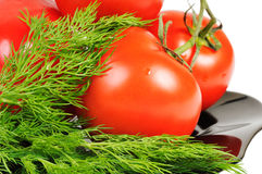 Tomatoes on a black plate Royalty Free Stock Images