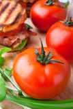 Tomatoes with a BLT sandwich Royalty Free Stock Photo