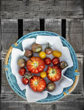 Tomatoes in blue basket with white napkin Stock Photography