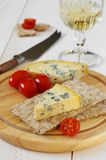Tomatoes, blue cheese on crispbread and glass of white wine Royalty Free Stock Images