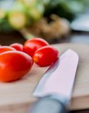 Tomatoes On Board Indicates Fresh Food And Cooking Stock Image