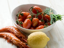 Tomatoes on bowl with shrimp Stock Photography