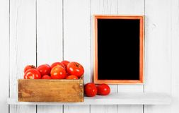 Tomatoes in a box Royalty Free Stock Photos
