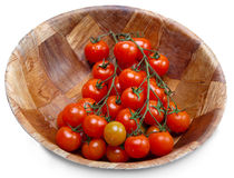 Tomatoes on a branch in a wooden bowl Royalty Free Stock Photography