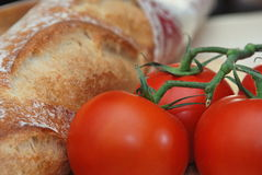 Tomatoes and bread Stock Photography