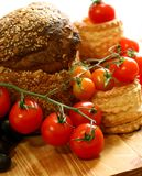 Tomatoes and bread on wooden Stock Photos