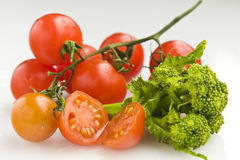 Tomatoes and broccoli. A bunch of tomatoes and broccoli Royalty Free Stock Photo