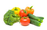 Tomatoes, broccoli, peppers and cucumbers  on white back Stock Photos