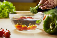 Tomatoes, broccoli and vegetables on kitchen table Royalty Free Stock Photo