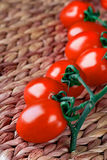 Tomatoes bunch closeup Stock Photos