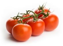 Tomatoes - bunch of six, studio high-key Stock Images