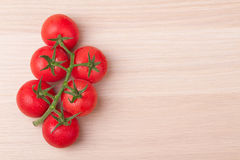 Tomatoes. Bunch of tomatoes on wood Stock Photo