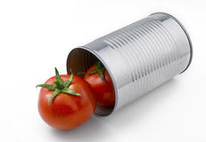 Tomatoes in can. Two natural tomatoes popping out of an aluminum can Royalty Free Stock Photos