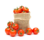 Tomatoes in a canvas bag on a white background Royalty Free Stock Images
