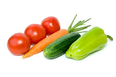 Tomatoes, carrot, cucumber and sweet pepper. Isolated on the white background stock photo