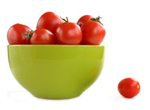 Tomatoes in a ceramic plate Stock Images