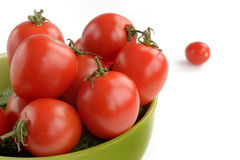 Tomatoes in a ceramic plate Royalty Free Stock Image