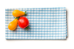 Tomatoes on checkered napkin Stock Image