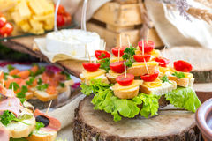 Tomatoes and cheese. Banquet feasts Royalty Free Stock Images