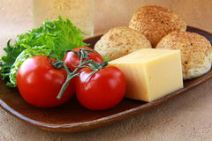 Tomatoes and cheese, bread a simple meal Stock Photos