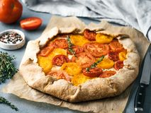 Tomatoes and cheese tart or galette royalty free stock photography