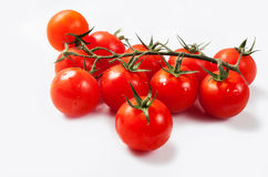 Tomatoes cherry branch isolated on white background Royalty Free Stock Photo