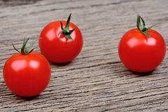 Tomatoes cherry on rustic table Stock Photography