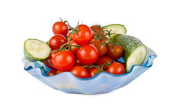 Tomatoes of cherry and slices of cucumbers Stock Photo