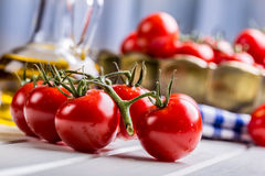 Tomatoes. Cherry tomatoes. Cocktail tomatoes. Fresh grape tomatoes carafe with olive oil Royalty Free Stock Image