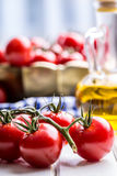 Tomatoes. Cherry tomatoes. Cocktail tomatoes. Fresh grape tomatoes carafe with olive oil Royalty Free Stock Photo