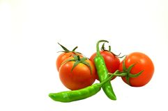Tomatoes and chillies Stock Image