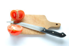 Tomatoes on chopping board Royalty Free Stock Images