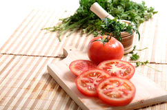 Tomatoes and cilantro Stock Photos