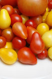 Tomatoes. Close up image of home grown tomatoes on white plate Royalty Free Stock Photo