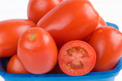 Tomatoes Closeup. Fresh tomatoes in a blue basket Royalty Free Stock Images