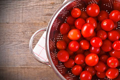 Tomatoes in colander. Royalty Free Stock Photos