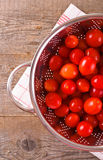 Tomatoes in colander. Royalty Free Stock Photo