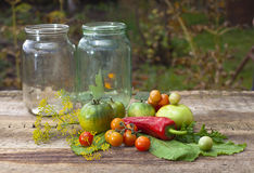 Tomatoes, cooked with herbs for the preservation on the old wood Royalty Free Stock Image