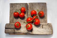 Tomatoes, cooked with herbs for the preservation. On the old wooden table on the old wooden table Stock Image