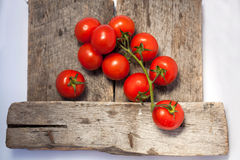 Tomatoes, cooked with herbs for the preservation. On the old wooden table on the old wooden table Royalty Free Stock Photo