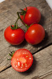Tomatoes, cooked with herbs for the preservation. On the old wooden table on the old wooden table Stock Photography