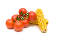 Tomatoes and corn closeup on white background Stock Photos
